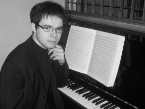Peter Bajetta music compose profile picture with piano